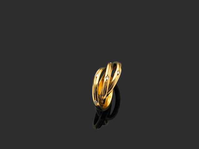 Cartier. A gold and diamond 'Trinity' ring