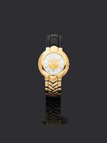 Versace. An 18ct gold automatic calender watch