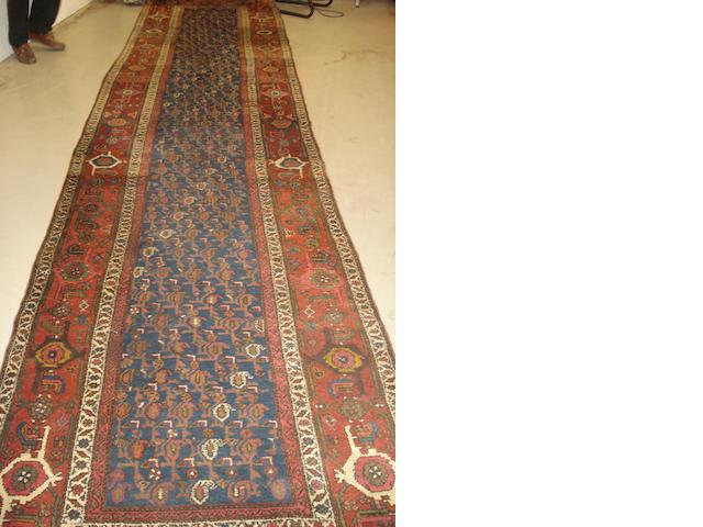 A North West Persian runner, 556cm x 125cm