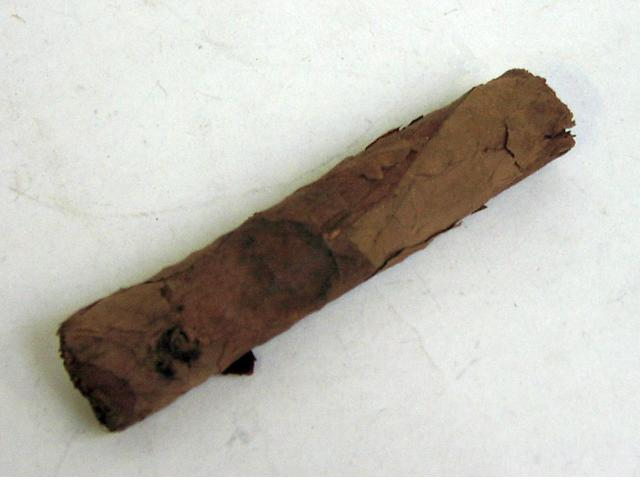 A partially smoked cigar, Sir Winston Churchill.