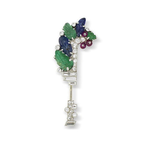 An art deco diamond and gem-set jabot pin,