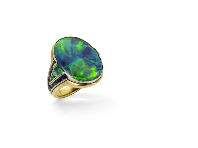 A black opal, sapphire and emerald ring, by Hemmerle,