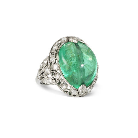 An early 20th century emerald bead and diamond ring
