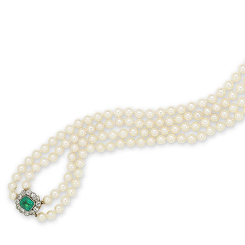 A two-row cultured pearl necklace with an early 20th century emerald and diamond clasp signed Bulgari