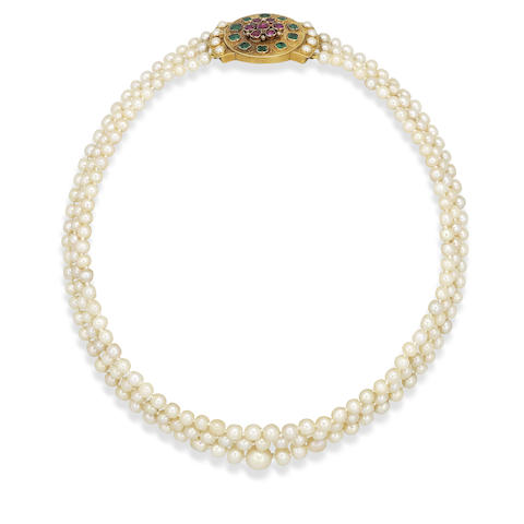 A late 19th century three-row natural pearl necklace with emerald, ruby and diamond clasp