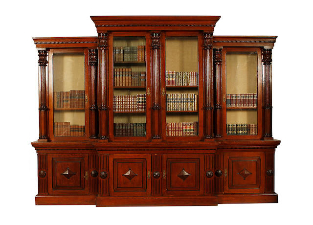 A large Victorian carved oak breakfront library bookcase by S.& H.Jewell