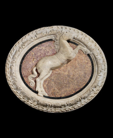 A 16th century Italian marble relief depicting a rearing horse After the Antique