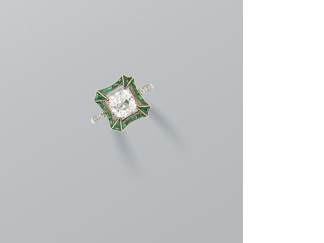 A diamond and emerald dress ring,