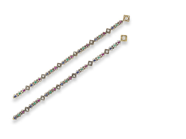 A pair of emerald, ruby, sapphire and diamond bracelets,