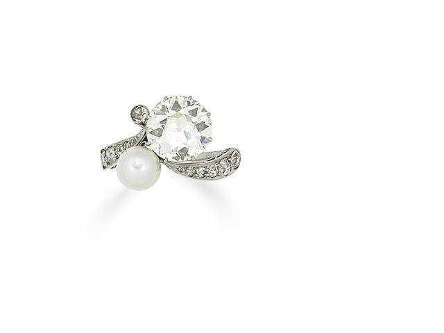 An early 20th century diamond and natural pearl ring,