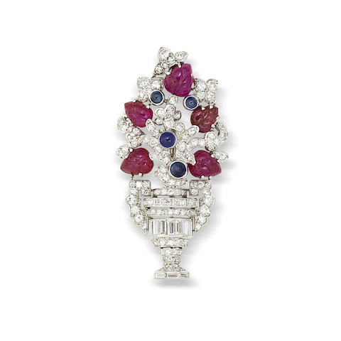 An art deco sapphire, carved ruby and diamond brooch, by Lacloche Frères,