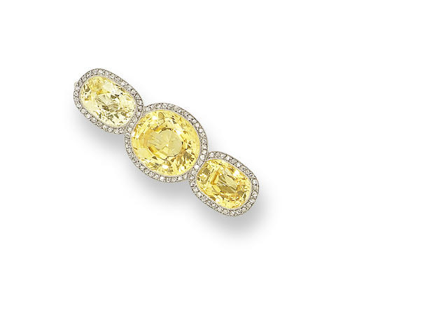 A yellow sapphire and diamond brooch,