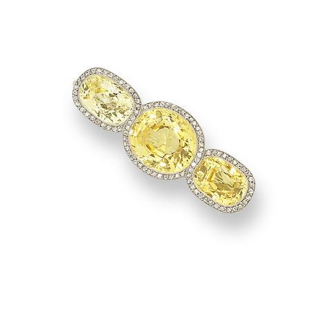 A yellow sapphire and diamond brooch,
