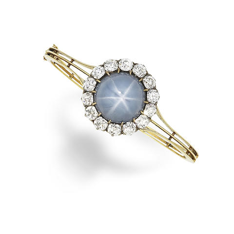 A star sapphire and diamond bangle,