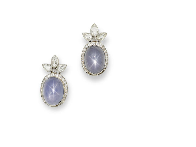 A pair of star sapphire and diamond earrings,
