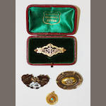 Three antique brooches and a pendant. (4)