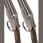A fine pair of 12-bore self-opening sidelock ejector guns by J. Purdey & Sons, no. 22308/9 In their brass-mounted oak and leather case