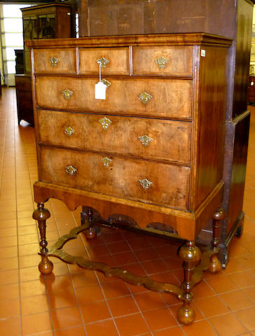 A William and Mary walnut and cross banded chest on stand
