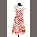 Alanis Morissette: a red and white polka dot dress worn in the film 'De-Lovely', 2004,
