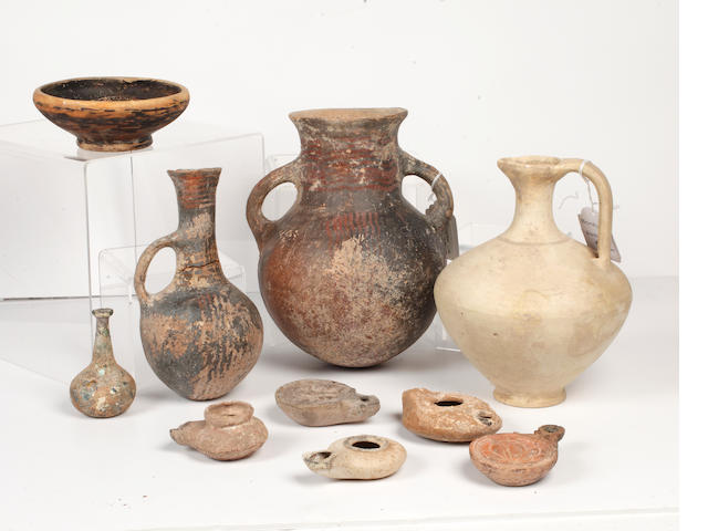 A Group of ancient pottery vessels and oil lamps 10