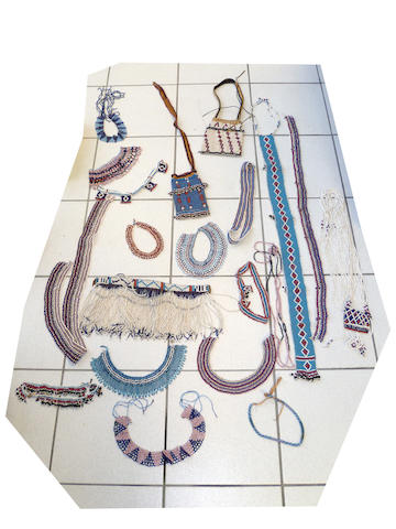 A collection of South Nguni, Mfengu beaded items  Eastern Cape, South Africa including two fringed bags, a narrow neckpiece with fringe, a fringed apron, and other smaller neck and waist ornaments (20)