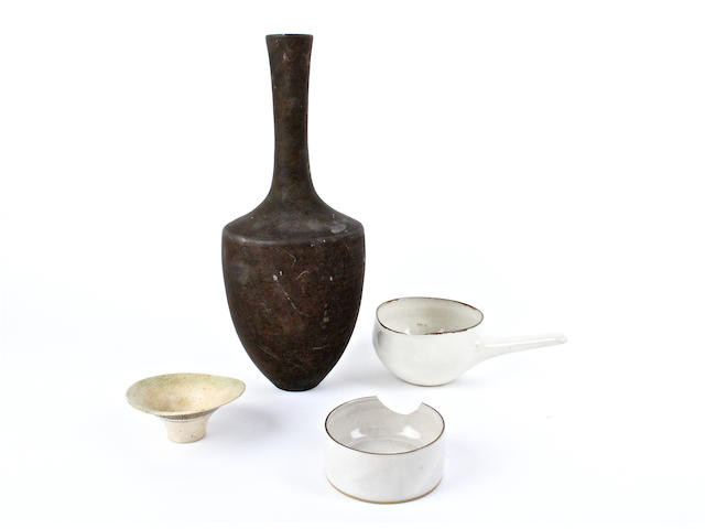 Three pieces by Lucie Rie and a vase in the style of Lucie Rie