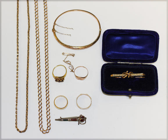 A small collection of gold jewellery items, including a hinged bangle, a 22ct gold wedding band, a 9ct gold wedding band, a curb-link chain, a belcher-link chain, etc.