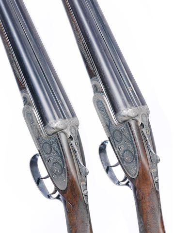 A fine pair of 12-bore self-opening sidelock ejector guns by J. Purdey & Sons, no. 25805/6 In their leather motor-case