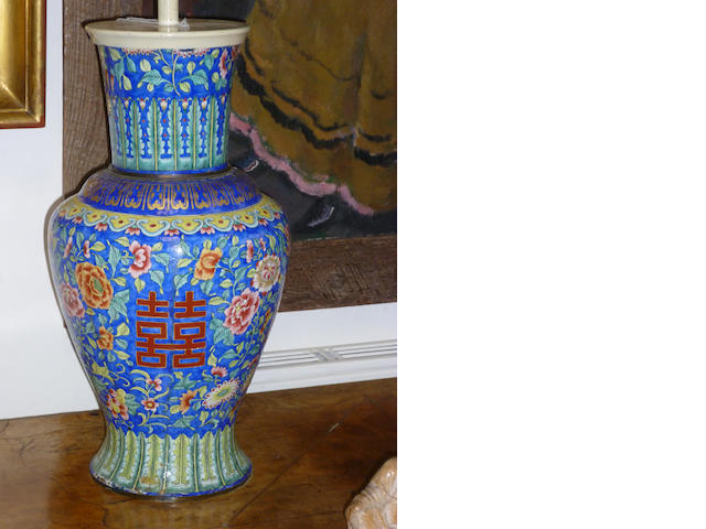 A 19th Century Chinese enamel vaseDecorated with floral designs on a blue ground, 36cm and a carved soapstone figure, 9cm high (2).