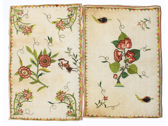 Two early 18th century embroidered and quilted cushion covers