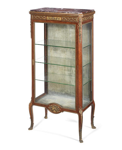 A French late 19th/ early 20th century ormolu-mounted satiné vitrine