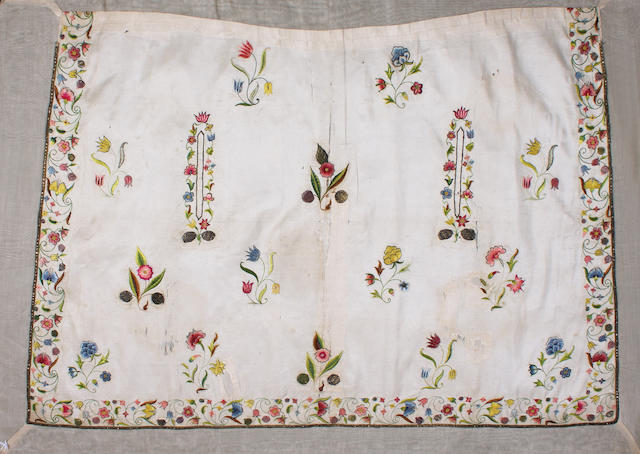 An 18th century embroidered apron and a tamboured panel