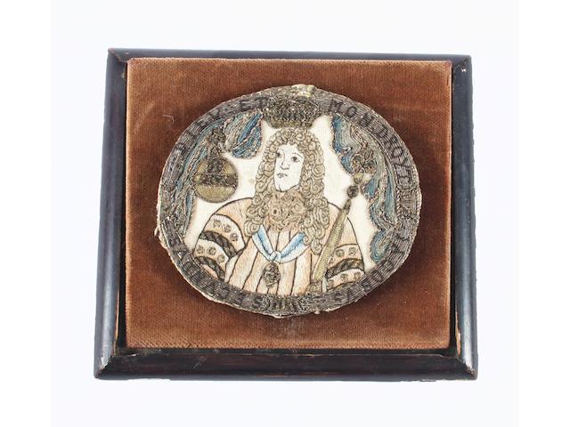 A late 17th century needlework handheld mirror