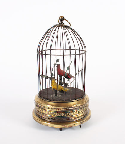 A singing bird in cage with twin birds and foliage,
