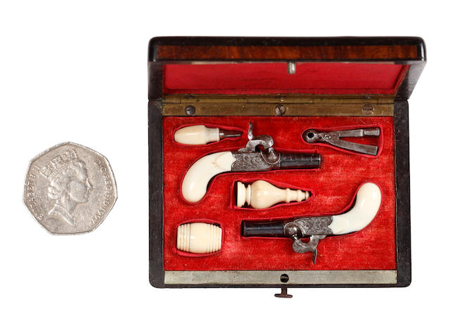 A Cased Pair of Continental Miniature Percussion Boxlock Pistols and a single Miniature Pinfire Pistol