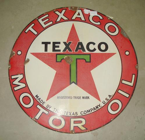 A circular Texaco Motor Oil enamel sign,
