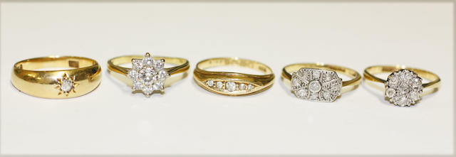 Five diamond set rings,
