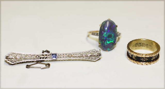 A black opal ring, a sapphire bar brooch and a mourning ring,