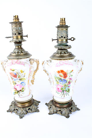 A pair of late 19th century Continental porcelain and brass table lamps