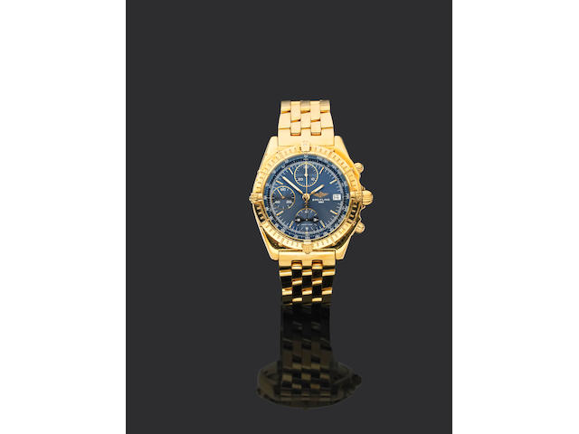 Breitling. An 18ct gold automatic chronograph bracelet watch
