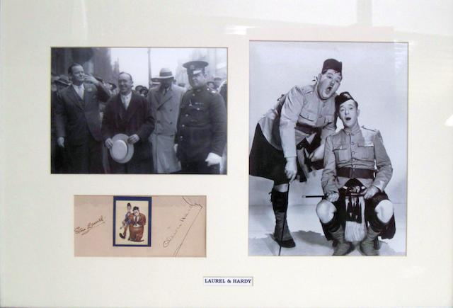 A Laurel and Hardy autographed page,