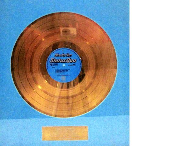 Status Quo: a Dutch 'Gold' sales award for 'Blue For You', March 1976,