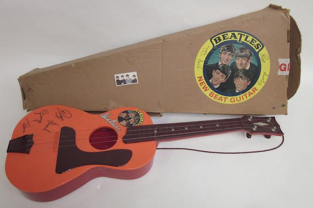 A Beatles 'New Beat' toy guitar, UK, circa 1964,