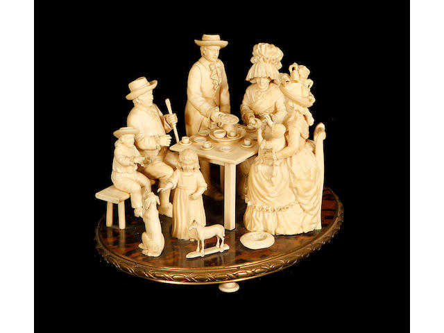 An unusual 19th century Dieppe ivory and tortoiseshell group depicting a family taking tea