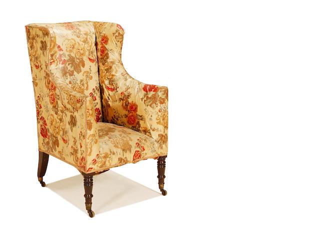 A late Victorian mahogany wingback armchair