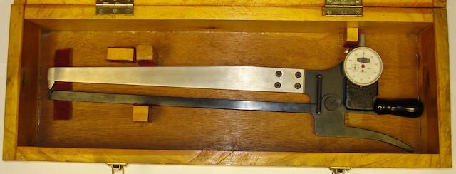 A TGM calliper wall-thickness gauge In a fitted wooden box