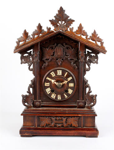 A Black forest style mantel cuckoo clock