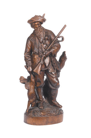 """A carved Black Forest figure of a hunter, most probably by Johann Huggler as per page 147 """"Black Forest Woodcarvings"""" by Peter F. Blackman"""