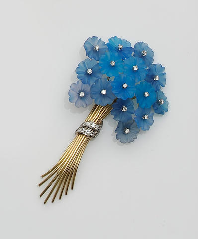 A diamond and blue hardstone flower brooch