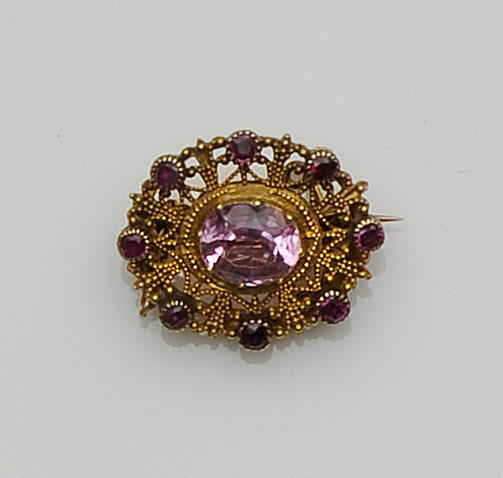 A pink topaz and ruby brooch